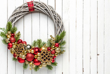 Christmas Wreath On Wood Background With Golden And Red Baubles And With Christmas Tree Branches