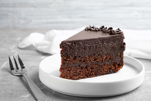 Delicious Fresh Chocolate Cake Served On Grey Table, Closeup