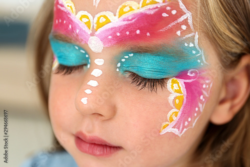Fotografie, Obraz  Cute little girl with face painting indoors, closeup