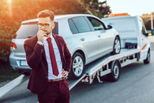 Elegant Middle Age Business Man Using Towing Service For Help Car Accident On The Road. Roadside Assistance Concept.