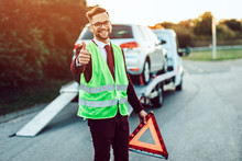 Elegant Middle Age Business Man Is Happy And Satisfied With Fast Towing Service For Help On The Road. He Showing Thumb Up. Roadside Assistance Concept.