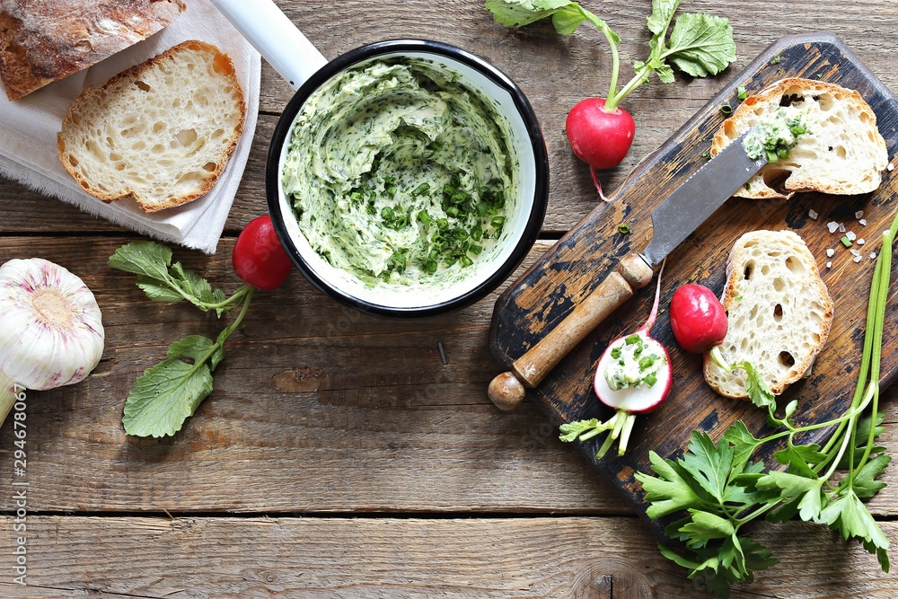 Flavored with herbs and garlic butter and fresh radishes overhead rustic wooden table <span>plik: #294678067 | autor: losangela</span>