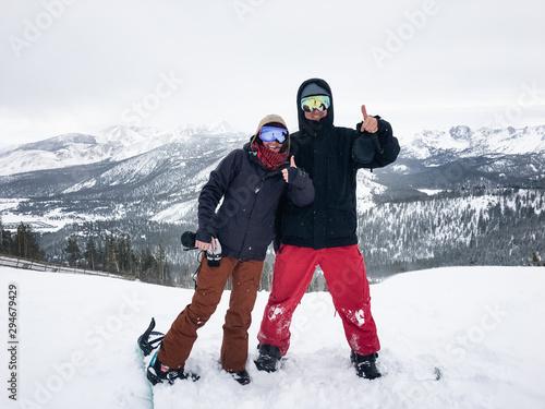 Happy Couple on Snowboards