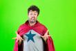canvas print picture - crazy super hero man making weird gestures over green background