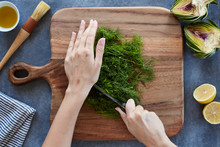 Anonymous Woman's Hands Cutting Herbs With A Sharp Knife