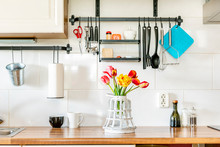 Kitchen Counter With Appliances And Beautiful Tulips