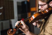 Man Playing On Violin In Studio