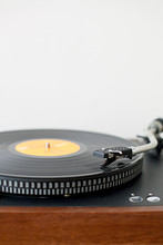 Close Up Of Record Player Against White Wall With Copyspace