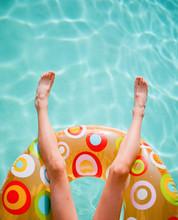 Boy Floating In Pool On Round Floatie