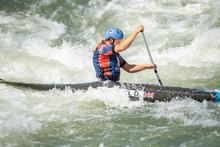Great Britain Canoe Slalom Athlete Paddles Across White Water