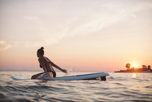 Woman On A Stand-Up Paddle