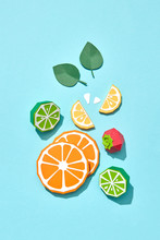 Handcraft Paper Kiwi Halves, Pieces Of Lemon, Orange Ripe Strawberries On A Blue Background With Space For Text. Fruit For Vitamin Salad. Flat Lay