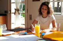 Young Woman Studying At Table ...