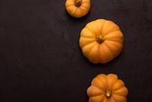 Pumpkins On Black Table. Hallo...