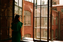 Woman Standing By The Window In Old Building