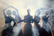 Ballerinas In Dresses Posing In Darkness