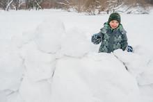 Little Boy In Snowballs