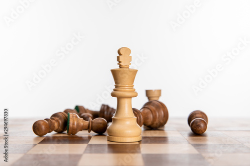 fototapeta na szkło black and white chess figures on chessboard isolated on white