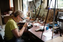 Woman Making Jewellery For Cli...