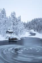 Icy Twirls In Frozen River