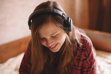 Happy Teenage Girl Listening M...