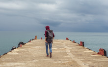 Traveler On A Pier In The Sea
