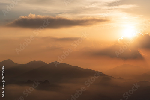 View to mountains on sunset rainforest landscape with clouds - 294710490