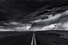 Heavy Storm And Cloudy Sky Over Road And Farm Fields, Black And White