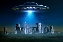 Flying Saucer Over Ancient Stonehenge With Light Ray In A Misty Night - 3D Rendering And Photomanipulation