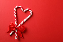 Sweet Candy Canes With Bow On ...