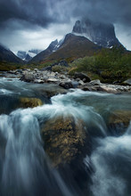Rushing River At The Base Of A...