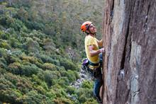 Smiling Rock Climber Ascends Technical Rock Face At Mount Wellington, Near Hobart, Tasmania