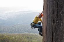 Side View Of A Male Rock Climber On Diorite Pillar, Mount Wellington, Tasmania