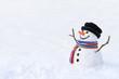 Leinwanddruck Bild - Cute snowman in deep snow