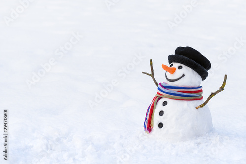 Fototapeta Cute snowman in deep snow