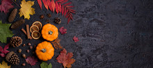 Autumn Leaves, Pumpkin, Pine Cones And Nuts On Black Background With Copy Space. Thanksgiving Concept. Flat Lay, Layout, Room For Text