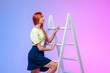 canvas print picture -  the girl climbs the ladder