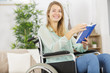 canvas print picture - disabled woman reading a book