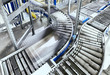 Leinwanddruck Bild - Transportation line conveyor roller with container in motion.