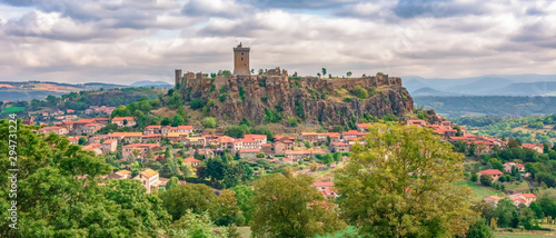 Photo Stands Old building Puy-en-Velay old city center beautiful France Auvergne green forest hills buildings Polignac Fortress