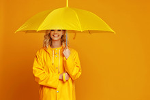 Ng Happy Emotional Girl Laughing  With Umbrella   On Colored Yellow Background.
