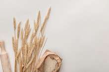 Top View Of Wheat Spikes, Rolling Pin And Flour Package Isolated On White