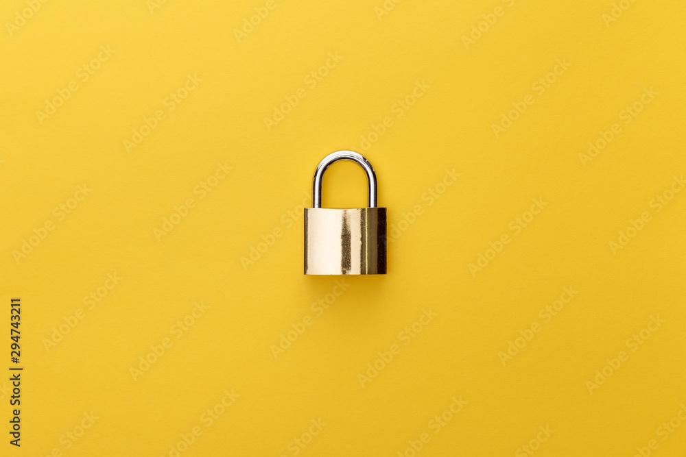 Fototapety, obrazy: top view of metal padlock on yellow background