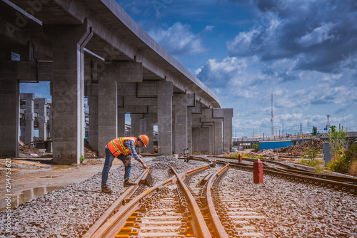 Fotografía  A engineer under inspection and checking construction process railway work on rail train station by Blueprint  on hand