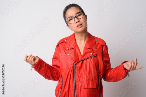 Obraz na płótnie Portrait of stressed young Asian rebellious woman looking confused