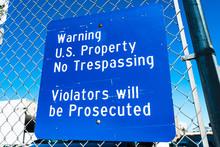 """Posted """"Warning US Property No..."""
