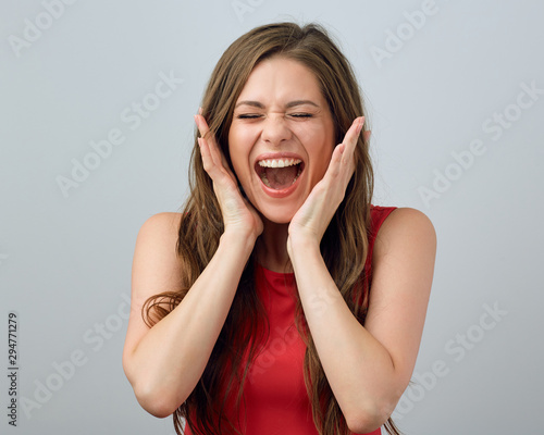 Photo Happy screaming woman touching face.