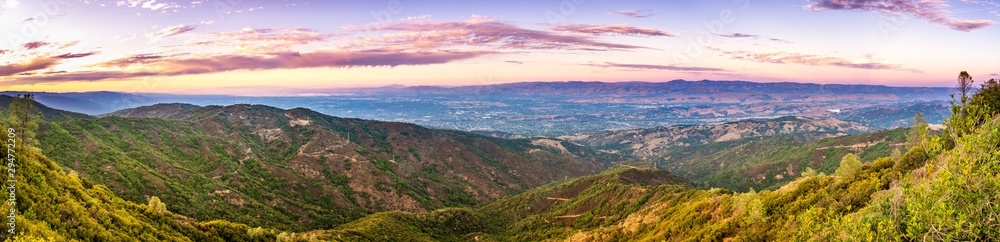 Fototapety, obrazy: Panoramic view towards San Jose and south San Francisco bay at sunset; Hills and valleys in the Santa Cruz mountains in the foreground; Diablo Range visible on the other side of the valley, California