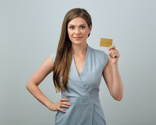 Smiling Business Woman Holding Gold Credit Card.