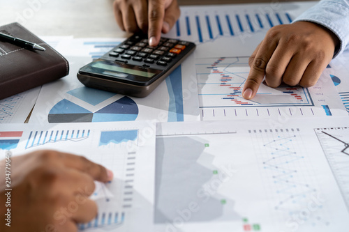 Photo sur Toile Pays d Asie businessman working using a calculator finance accounting concept achievement to balance man assistant accounting